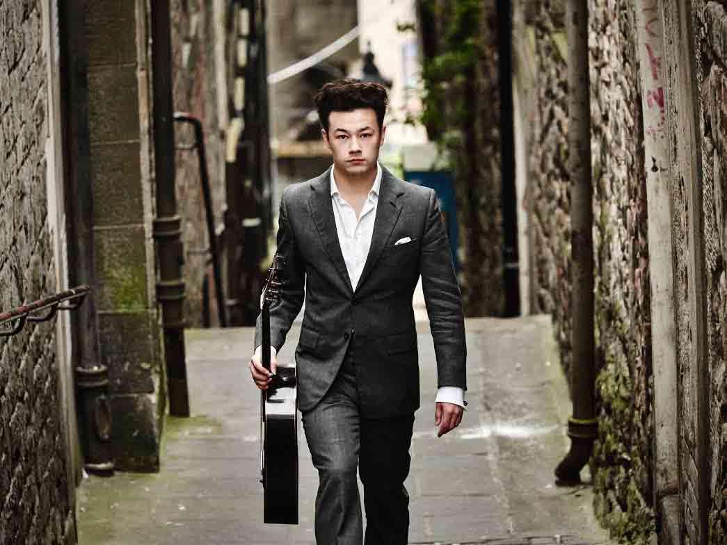 Sean Shibe walking along alley by Kaupo Kikkas